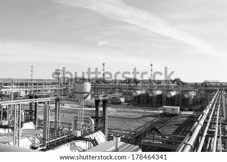 Industrial zone. Steel pipelines, valves and ladders - stock photo