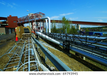 Industrial zone, Steel pipelines, valves and ladders - stock photo