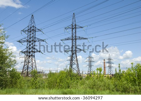 Industrial zone. Transmission tower - stock photo