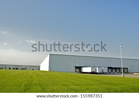 Industrial Zone - Warehouses with Truck Gates and Green Field. Industrial Collection. - stock photo