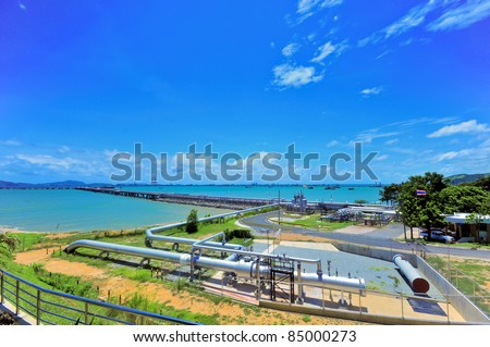 Industrial zones, industrial steel pipes at the seaside. - stock photo