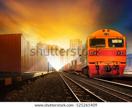 industries container trains and boxcar on track against building in town for industrial logistic and land transportation