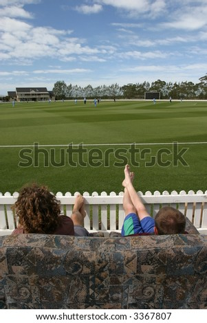 Industrious spectators who dragged out some couches to watch an International cricket match between the India and New Zealand woman's cricket teams at the Bert Sutclilffe Oval in Lincoln, New Zealand - stock photo