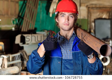 Industry. A worker at a manufacturing area. - stock photo