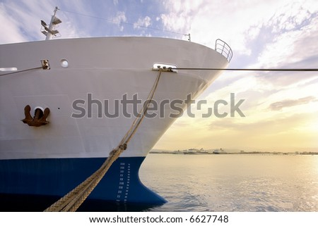 industry and commerce: cargo ship anchored in a harbor - stock photo