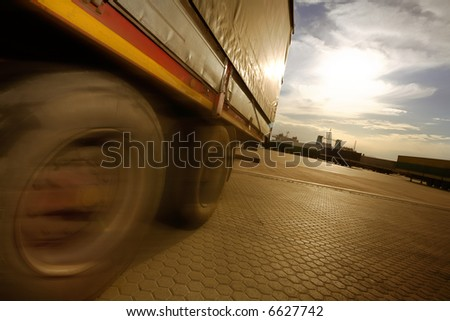 industry and commerce: truck parking in a harbor - stock photo