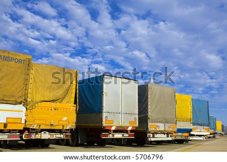 industry and commerce: trucks parked in a harbor - stock photo