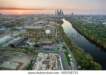 Industry area, river, sunset and skyscrapers far away in Moscow, Russia - stock photo