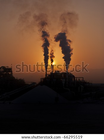 Industry blowing fumes into the air - stock photo