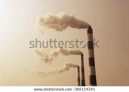 Industry Chimney Emitting Smoke - stock photo
