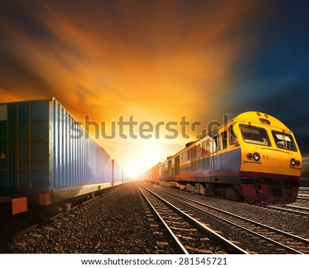 industry container trains running on railways track against beautiful sun set sky use for land transport and logistic business  - stock photo