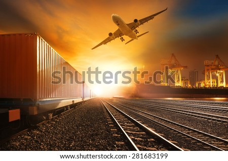 industry container trains running on railways track and commercial ship in port ,plane air cargo flying above  use for land ,air ,and vessel transport industry  and logistic business  - stock photo