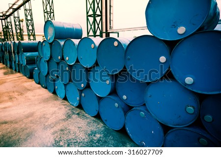 Industry oil barrels or chemical drums stacked up. Fillter image processed. - stock photo