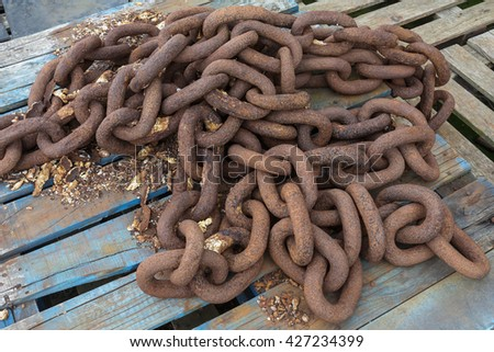 Industry - Pile of rusty old chains - stock photo