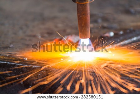 Industry steel, Sparkles, Fire gas cutting slab.