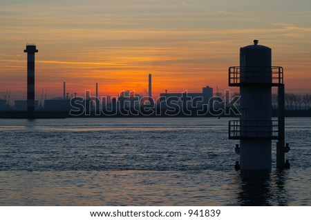 Industry sunset at the coast. - stock photo