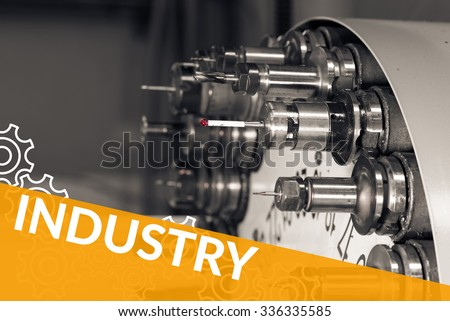 Industry word concept image with gears on orange background and Rotating head with drilling machine bits and tools in a high precision mechanics plant at CNC lathe in workshop on background - stock photo