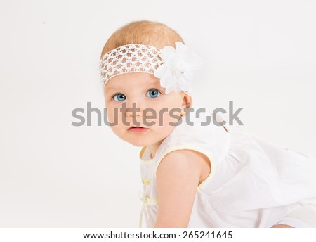 infant age ten months on a white background - stock photo