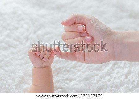 infant baby holding hand promise