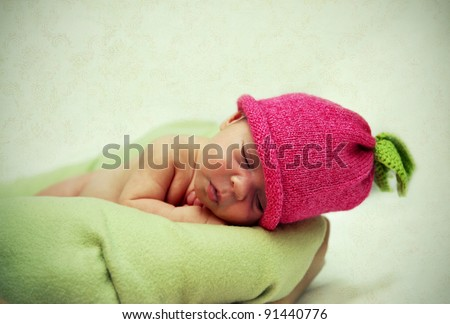 infant baby in a hat sleeping - stock photo
