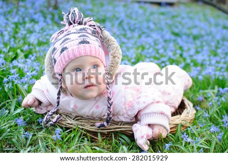 Infant baby in snowdrops