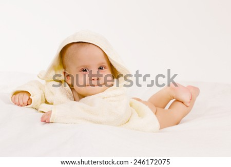 Infant baby in towel on white background - stock photo