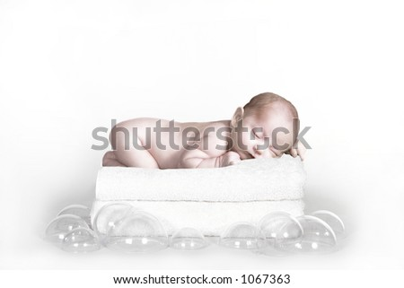Infant Baby on Wash Towels and Bubbles Fantasy Portrait - stock photo