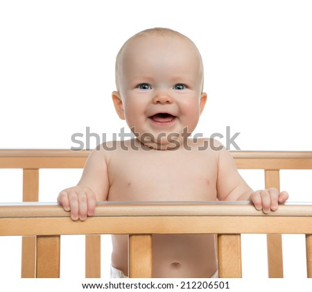 Infant child baby boy toddler shouting or yelling in wooden bed on white background