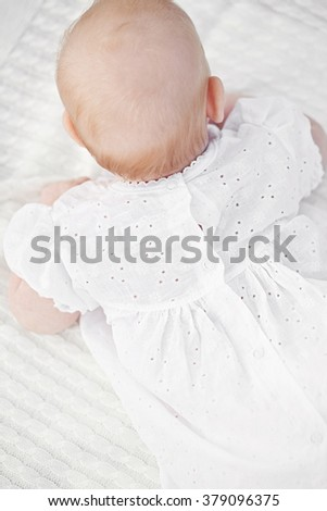 Infant Child Baby Lying Happy Smiling on Knit Blanket on a White Background - stock photo