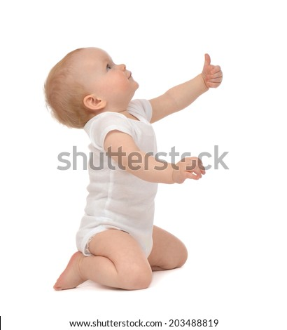 Infant child baby toddler happy looking up smiling with hand thumb up sign isolated on a white background - stock photo