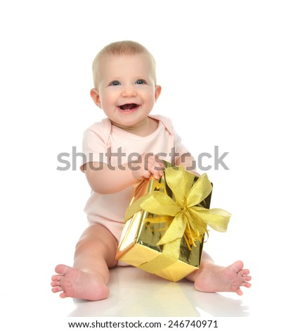 Infant child baby toddler kid with gold  present gift for birthday or valentines day  isolated on a white background  - stock photo