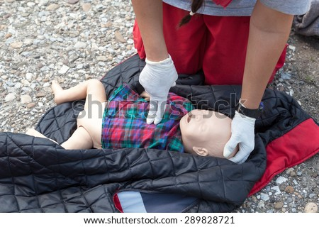 Infant dummy first aid. CPR. - stock photo