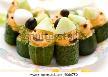 infant food - stuffed cucumbers, designed like gnomes - stock photo