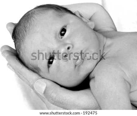 Infant in father's hands