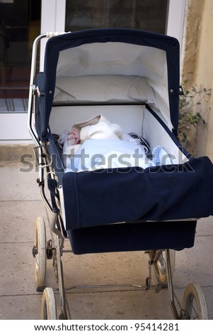 Infant in stroller, outdoor - stock photo