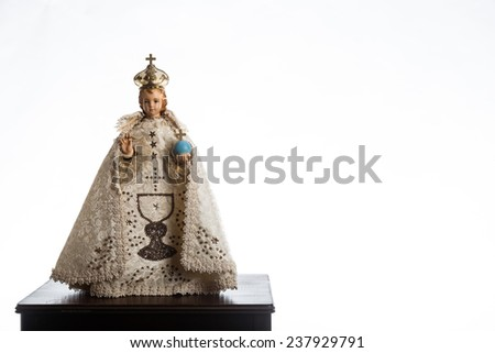 Infant Jesus of Prague in white vestments on a white background - stock photo