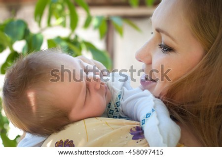 Infant napping in mother lovely embrace