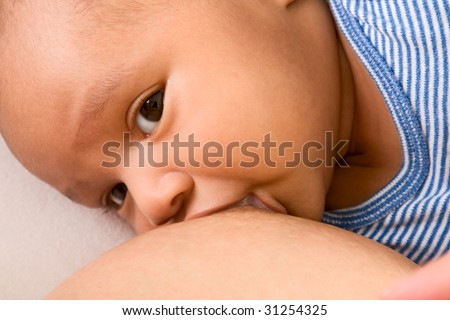 Infant of mixed ethnicity (Hispanic and African-American) is breastfed - stock photo