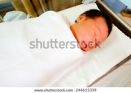 Infant sleeping in bed for baby - stock photo