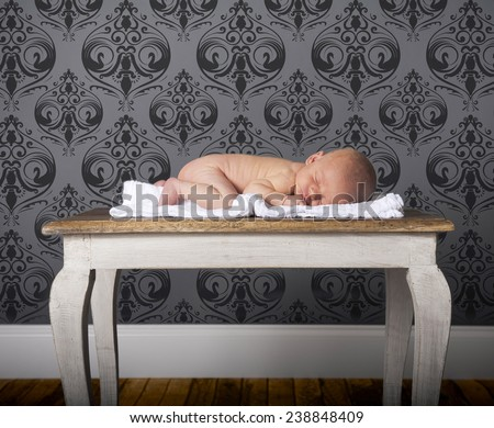 Infant sleeping nude on stomach - stock photo