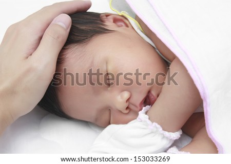 infant sleeping on white bed after drink milk - stock photo