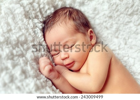 infant sleeps in a dream emotions - stock photo