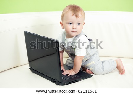 Infant using laptop