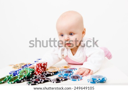 infant with chips from the casino. studio