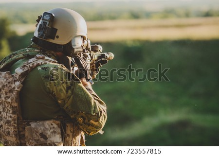 Infantry soldier shooting during military combat training.war, army, weapon, technology and people concept.