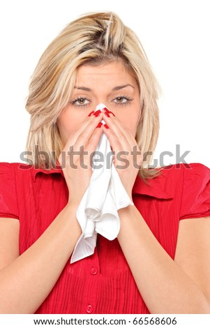 Infected woman blowing his nose in tissue paper because of being ill isolated on white background - stock photo