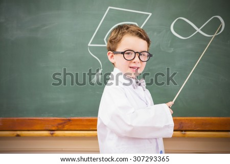 Infinite loop against cute pupil holding stick and pointing blackboard - stock photo
