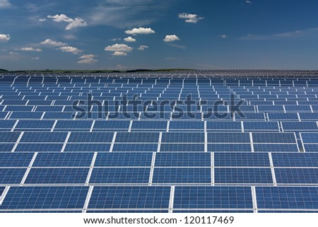 Infinite series of solar collectors - stock photo