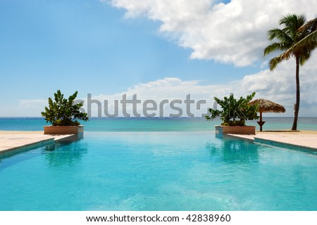 Infinity Luxury Swimming Pool on the Beach - stock photo