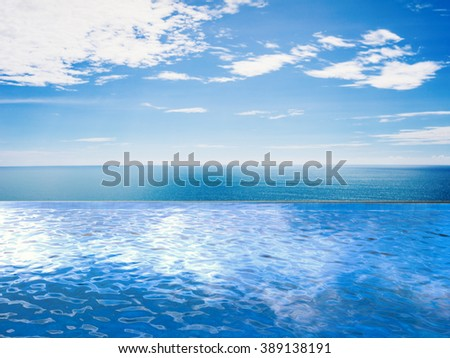 infinity pool with blue sea and blue sky  - stock photo